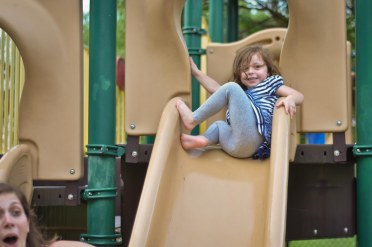 This photo cracks me up. Izzy tooted going down the slide- hence my sister's reaction.