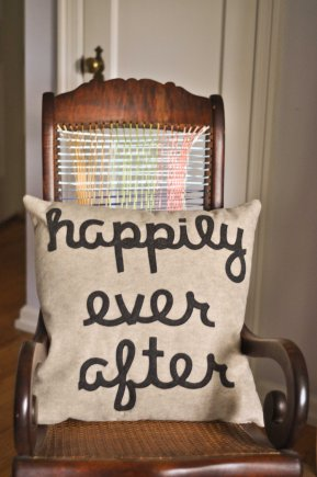 Cute pillow given as a wedding gift. Rocking chair was a dumpster find- had no backing so we weaved ribbon.