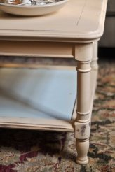 Detail of water-stained Grange coffee table we painted and distressed. Table was generously gifted to us. For the blue lower portion of the table, when we asked for the smallest paint can available, the store gave us a free sample can which was more than enough to do the job.